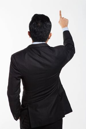 Business man in suit facing back and doing hand gesture