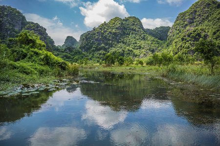 endlessly: View of mountains reflected in the water Stock Photo