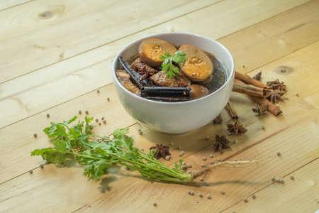 stewed: Eggs Stewed on wooden plate