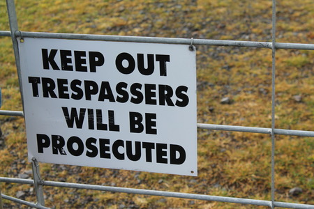 Keep out trespassers will be prosecuted sign photo