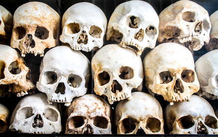 Pile of Skeleton Heads laid on top of each other, Killing Fields, Phnom Penh. Stock fotó