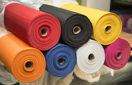 fabric patterns: Colorful material fabric rolls - texture samples Stock Photo