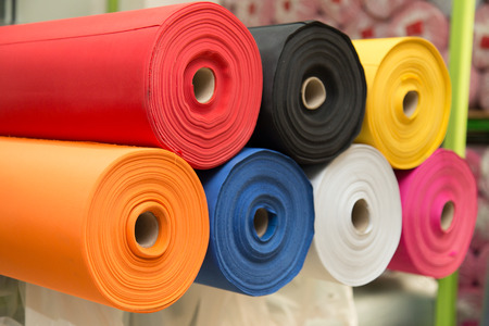 Colorful material fabric rolls - texture samples Foto de archivo