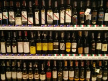 Wine Liquor bottle on shelf - Blurred background Stock Photo