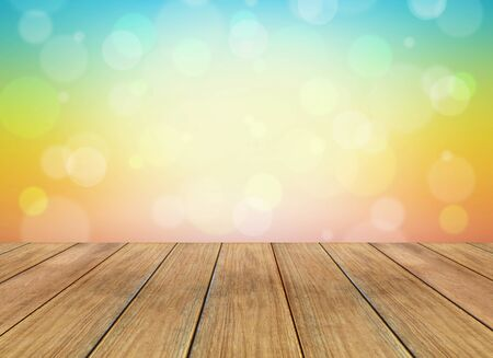 wooden plank: Abstract colorful background with bokeh lights and wooden plank Stock Photo