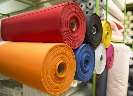 Colorful material texture of fabric rolls and in warehouse Archivio Fotografico