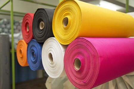 pink texture: Colorful material texture of fabric rolls and in warehouse Stock Photo