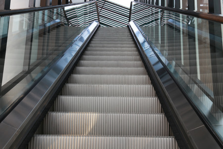 escalate: escalators and stairs in office building interior