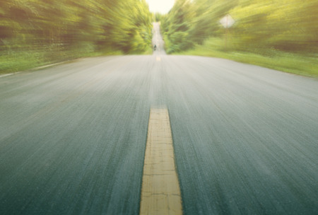 walking paths: Road with motion blur in country road Stock Photo