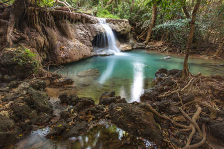 jungle: tropical waterfall in deep forest of Kanchanaburi province, Thailand.