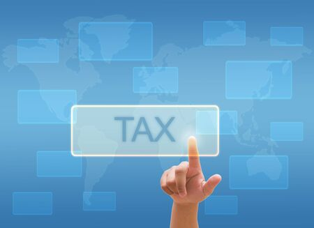 government services: hand touching TAX on virtual screen interface Stock Photo