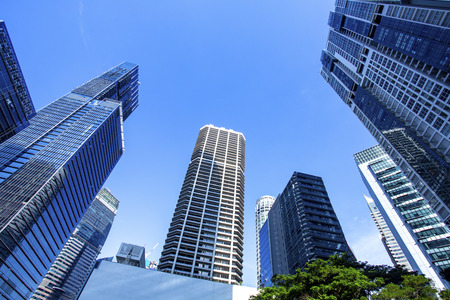 Skyscrapers in financial district of Singapore, office buildings of modern megalopolis 스톡 콘텐츠