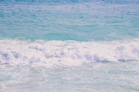 Splashing waves on the rocks and blue sky