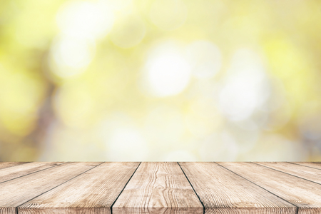 Empty wood table top with abstract natural bokeh background 스톡 콘텐츠