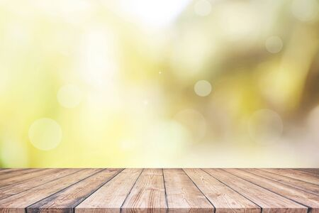 Abstract spring or summer with bokeh background and wooden table Imagens
