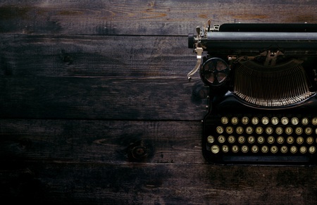 Old beautiful typewriter on the wooden table