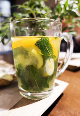 Tea with mint and lemon. Glass cup.