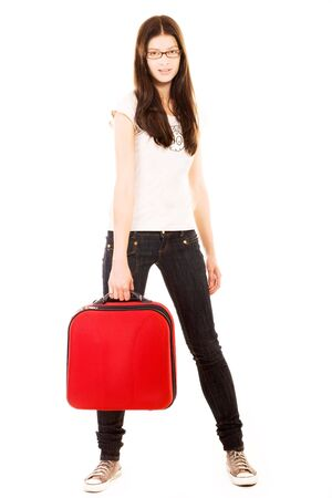Smiling young girl with suitcase on a white background Stock Photo