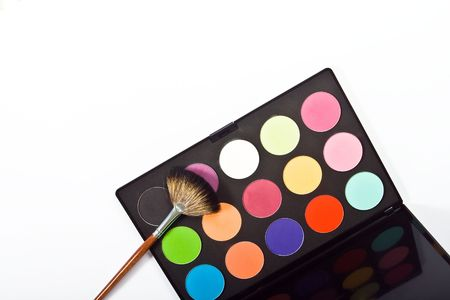 Make-up palette with brushes on white background. top view Stock Photo