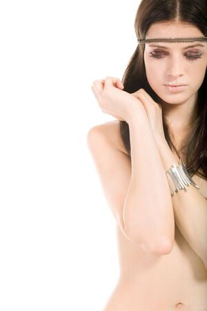 Torso of naked female keeping her arms on breasts over white background  Stock Photo