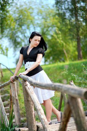 Young girl on the bridge  Stock Photo