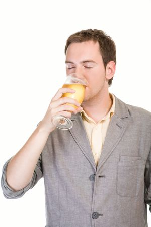 Young man drinking beer on white background Stock Photo
