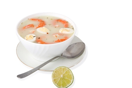Creamy prawn soup with eggs over white