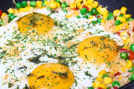 Fried eggs with vegetables, close-up Stock Photo - 9898077