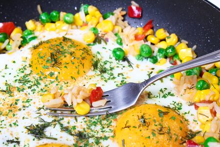 Fried eggs with vegetables, close-up Stock Photo - 9898081