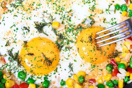 Fried eggs with vegetables, close-up Stock Photo - 9898163