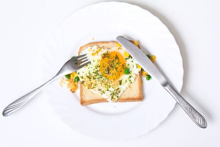 Fried egg on toast bread on a white plate, top-view Stock Photo - 9898016