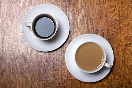two cups of black and white coffee
