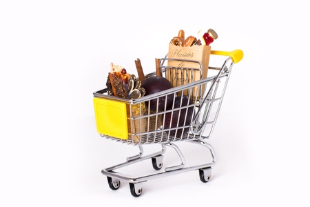 Shopping cart with bags of spices, gourmet food and plums