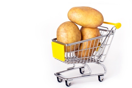 Shopping cart with three large potatoes Stock Photo