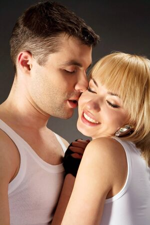 The young couple embraces in studio
