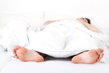 Sleeping man under a white blanket Stock Photo - 9897957