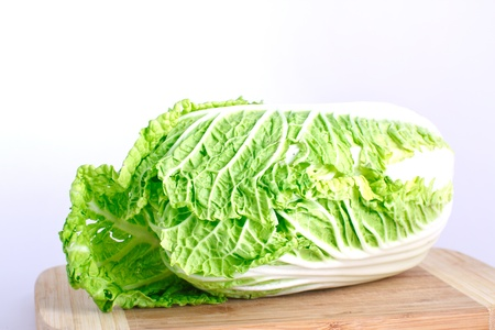 Fresh cabbage on the wood desk isolated on the white background