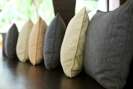 Line of pillows. Focus on the second cushion