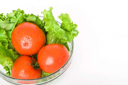 fresh tomato and lettuce in bowl isolated on white