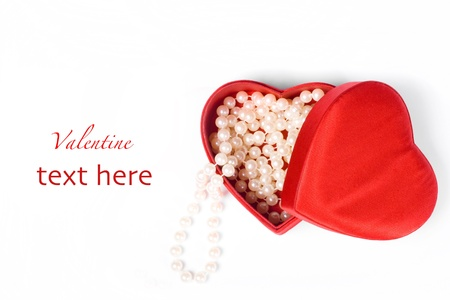 Pearl necklace in gift red box on white background
