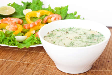 Soup with a salad on a wooden tablecloth
