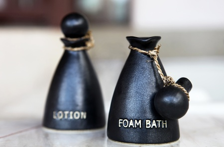 Foam bath and lotion in the special jars Stock Photo