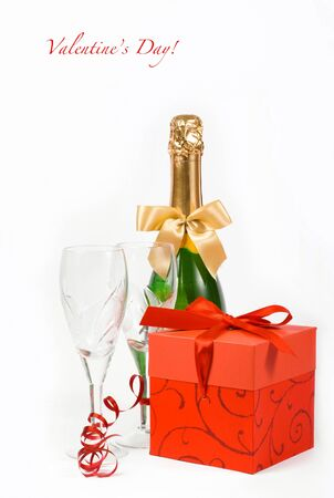 gift in box, champagne and glasses on white background  Stock Photo