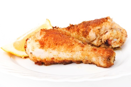 �hicken legs on a white plate