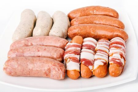 Some kind sausages on white plate