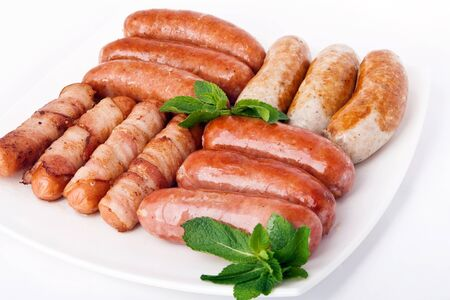 Grilled sausages on white plate