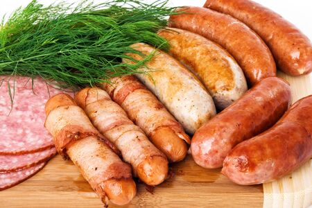 Grilled sausages on wooden plate