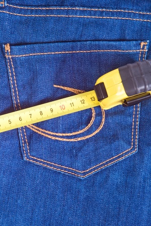 a pocket of blue jeans and measure