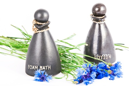 Foam bath and lotion with cornflowers on white Stock Photo