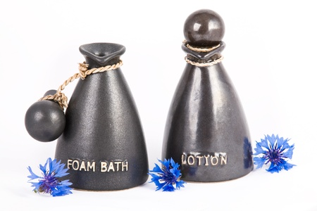 Bottle with bath gel and body lotion Foam bath and lotion in the special jars Stock Photo